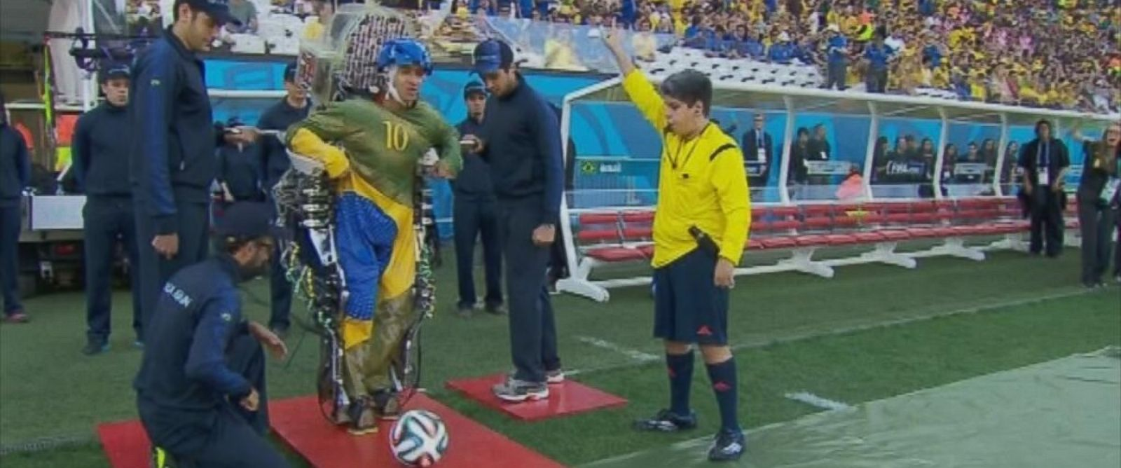 PHOTO: A paraplegic man wears an exoskeleton kicks a soccer ball