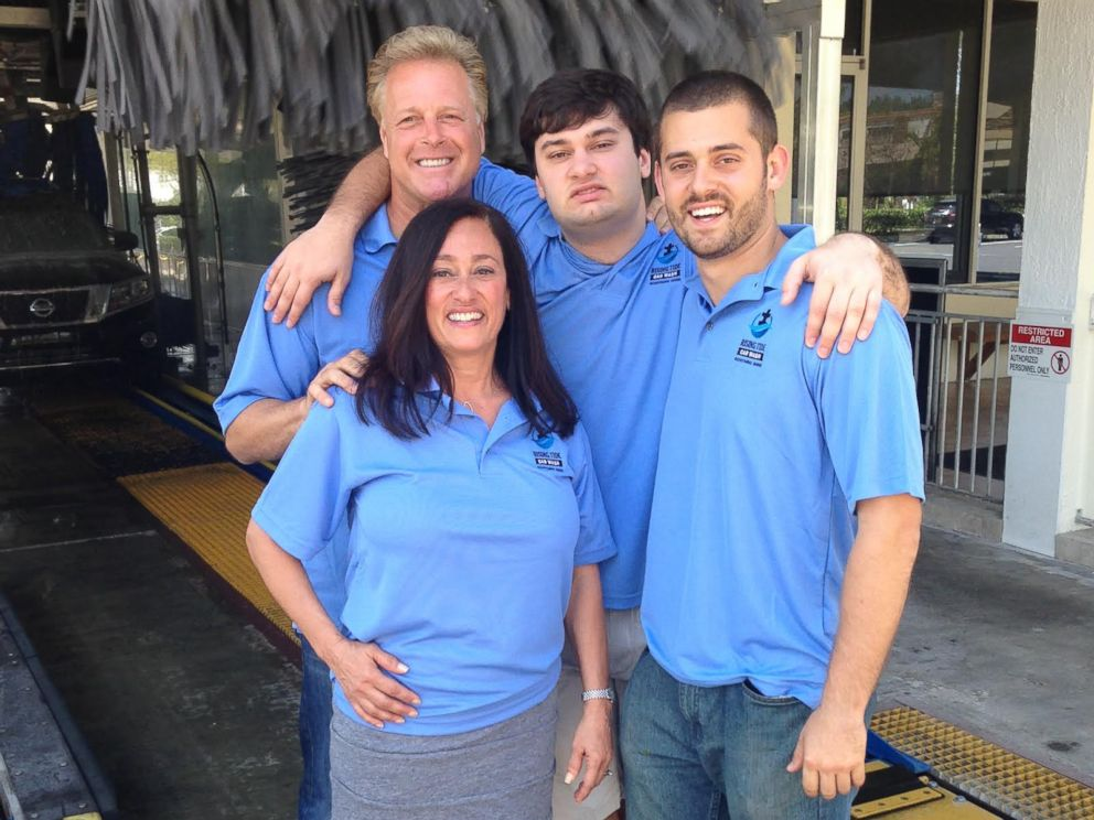 PHOTO: The DEri family poses for a photo at Rising Tide Car Wash.
