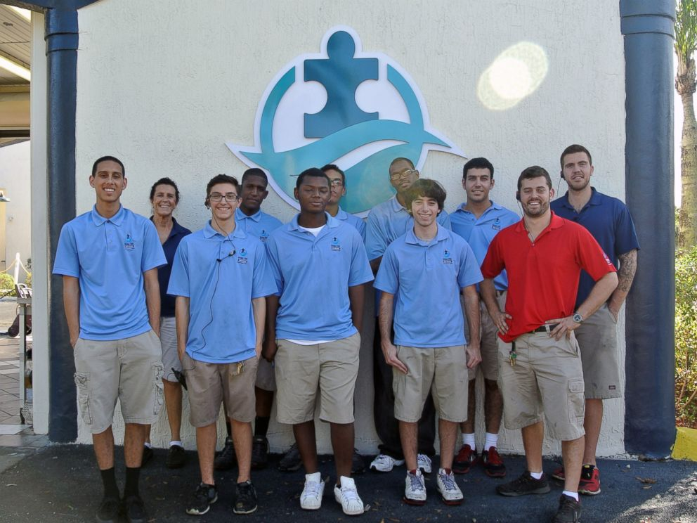 PHOTO: Employees of Rising Tide Car Wash pose for a photo.