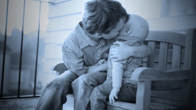 PHOTO: Autistic boy with infant brother