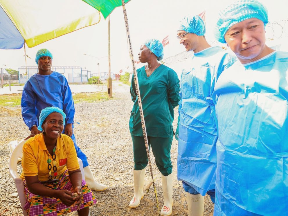 PHOTO: Beatrice Yardolo poses for a photo with staff members of the Chinese Ebola treatment unit on the day of her release in Monrovia, Liberia on March 5, 2015.