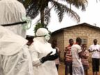 PHOTO: After failing to convince three suspected Ebola victims to go with them to an Ebola treatment center in Monrovia, Liberia, health care workers speak to a small crowd that has gathered.