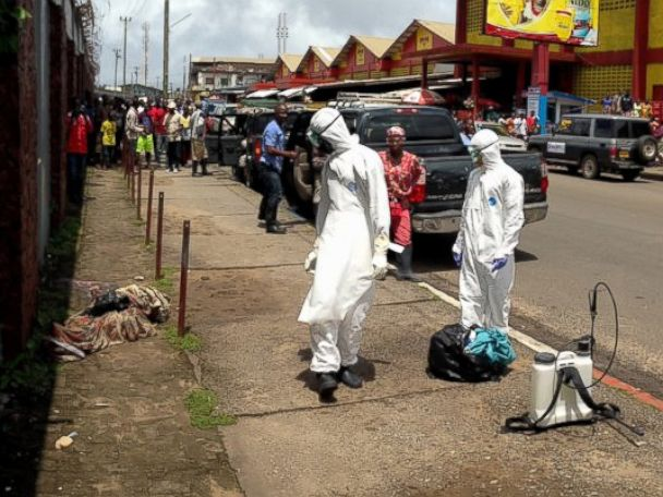 PHOTO: A burial team discovers a man thought to be dead was actually alive in Liberia on Oct. 2, 2014.