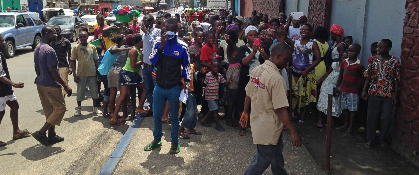 PHOTO: A crowd watches as a burial team discovers a man thought to be dead was actually alive in Liberia on Oct. 2, 2014.