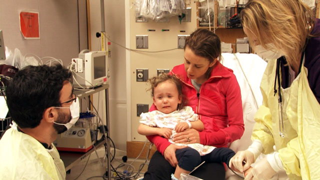 PHOTO: Little Cassie is treated at Bostons Childrens Hospital when her mother brings her in with suspected flu symptoms. She was one of dozens of patients Boston-area hospital treated for flu in the past 48 hours.