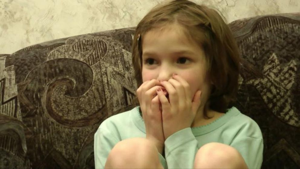 VIDEO: Robert Losits made a video of his 8-year-old daughter watching a video of her birth.