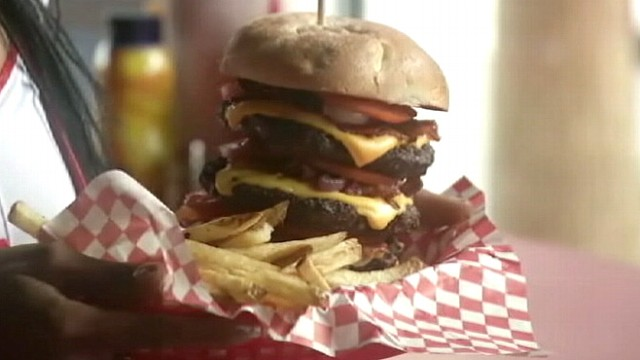 """VIDEO: Heart Attack Grill in Las Vegas offers customers a """"Quadruple Bypass"""" burger."""