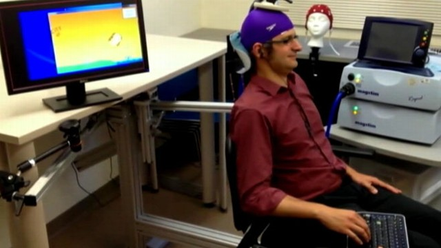 VIDEO: University of Washington researcher controls colleagues motion in brain-to brain interface.