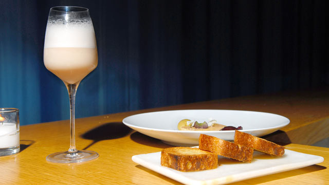 PHOTO: Aldea's Raymos Gin Fizz cocktail is seen here along with their signature Foie gras.