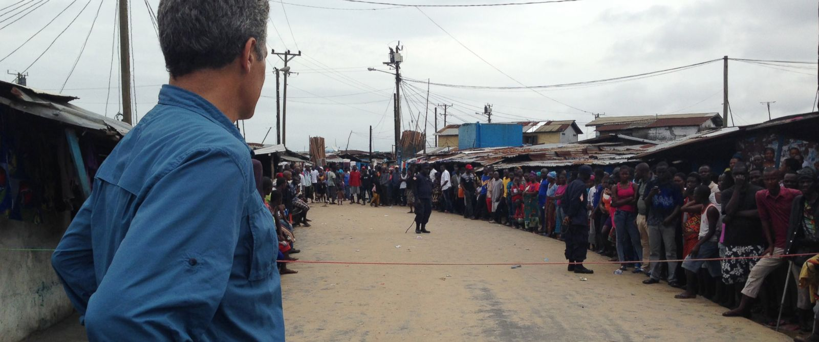 PHOTO: People line the streets of West Point, a slum at the center of an Ebola outbreak in Monrovia, Liberia on Aug. 27, 2014.