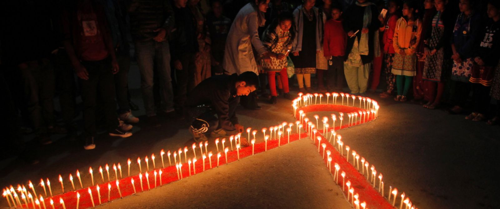 PHOTO: Nepalese women and children from ?Maiti Nepal?, a rehabilitation center for victims of sex trafficking, light candles on the eve of World AIDS Day in Kathmandu, Nepal, Nov. 30, 2015.