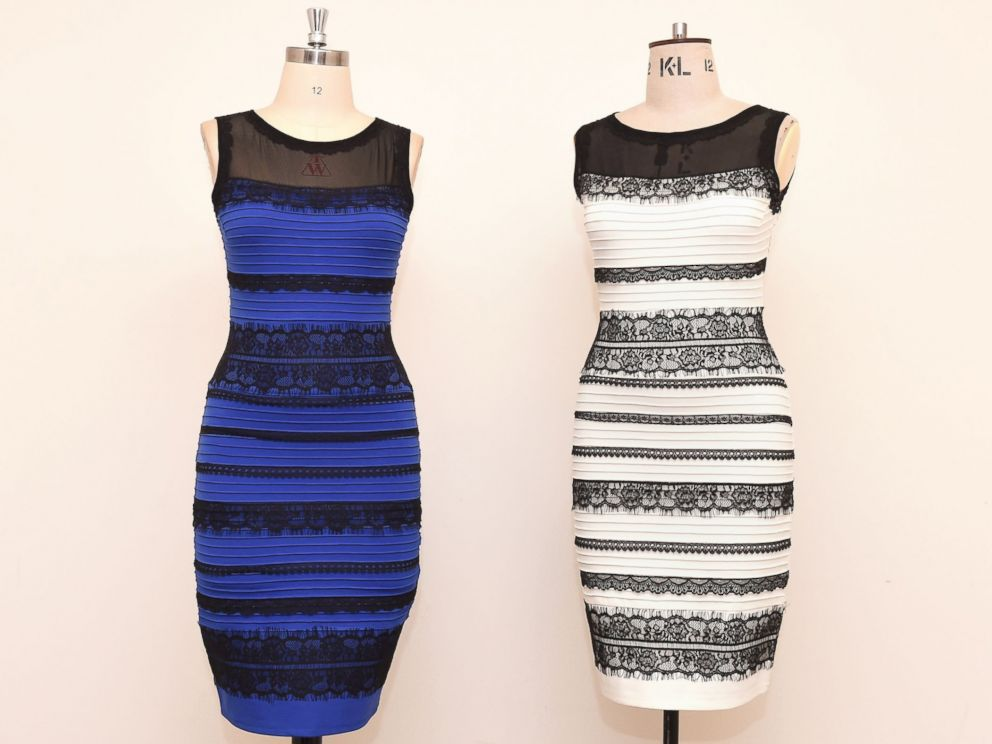 PHOTO: The two-tone dress, left, alongside an ivory and black version, made by Roman Originals, that has sparked a global debate on Twitter over what color it is on display in Birmingham, England on Feb. 27, 2015.