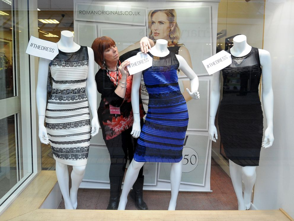 PHOTO: Shop manager Debbie Armstrong adjusts a two tone dress in a window display of a shop in Lichfield, England on Feb. 27, 2015.