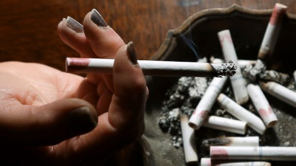 PHOTO: A woman smokes a cigarette at her home in Hayneville, Ala., March 2, 2013.