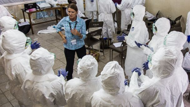 PHOTO: A World Health Organization, WHO, worker, left center, trains nurses to use Ebola protective gear in Freetown, Sierra Leone, Sept. 18, 2014.