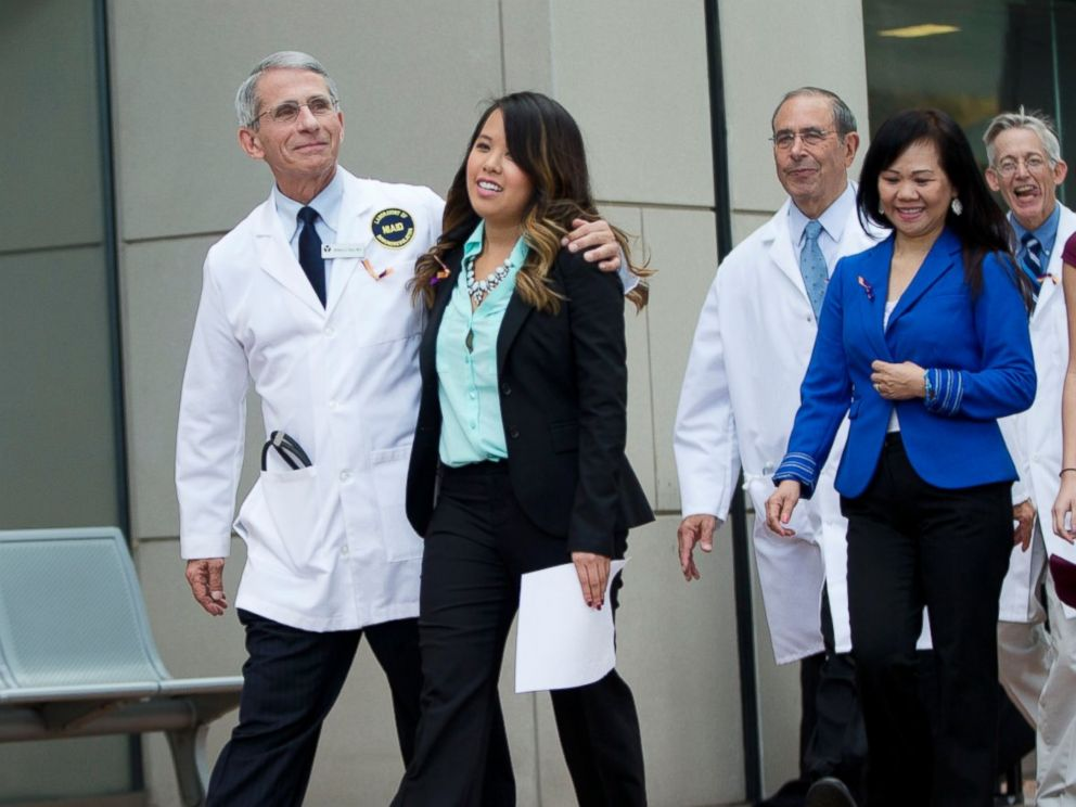 PHOTO: Patient Nina Pham is escorted outside of National Institutes of Health in Bethesda, Md., Oct. 24, 2014.