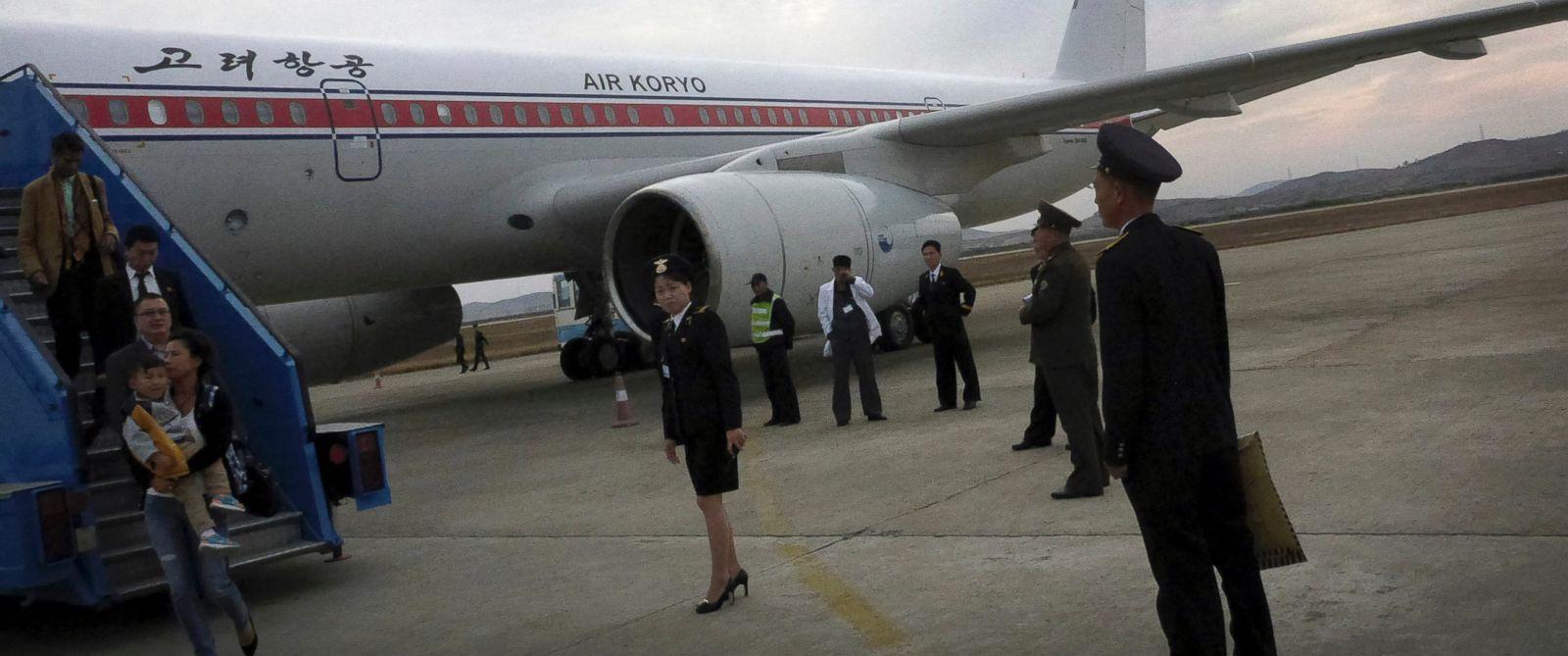 PHOTO: Passengers disembark an Air Koryo flight in Pyongyang, North Korea on Oct. 21, 2014.
