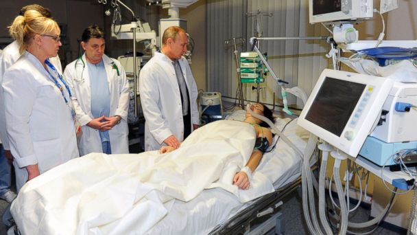 PHOTO: In this photo provided by RIA Novosti Kremlin, Russian President Vladimir Putin, center, speaks to skier Maria Komissarova in a hospital in Krasnaya Polyana, Russia, on Feb. 15, 2014.
