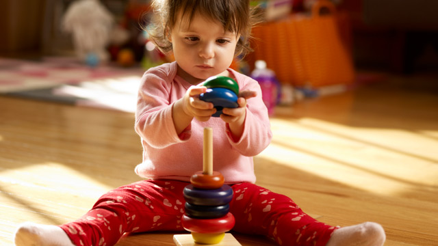 PHOTO: Baby plays with toy