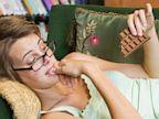 PHOTO: Woman eating chocolate bar