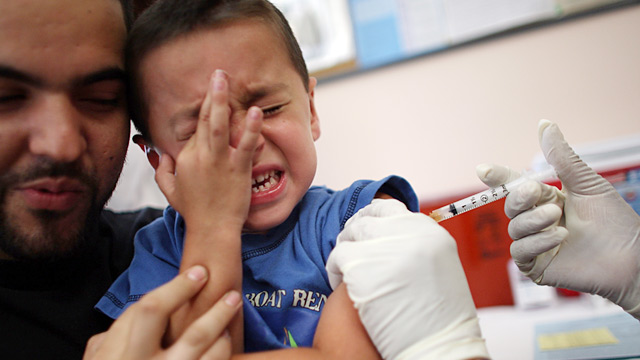 PHOTO: Child being vaccinated