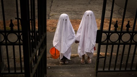 gty children trick or treat ghosts jt 111030 wblog How to Keep Your Kids Safe and Healthy on Halloween