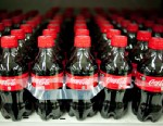 PHOTO: Bottles of Coca-Cola Co. soda sit on display in a supermarket in Princeton, Illinois, U.S. in this Oct. 12, 2012 file photo.