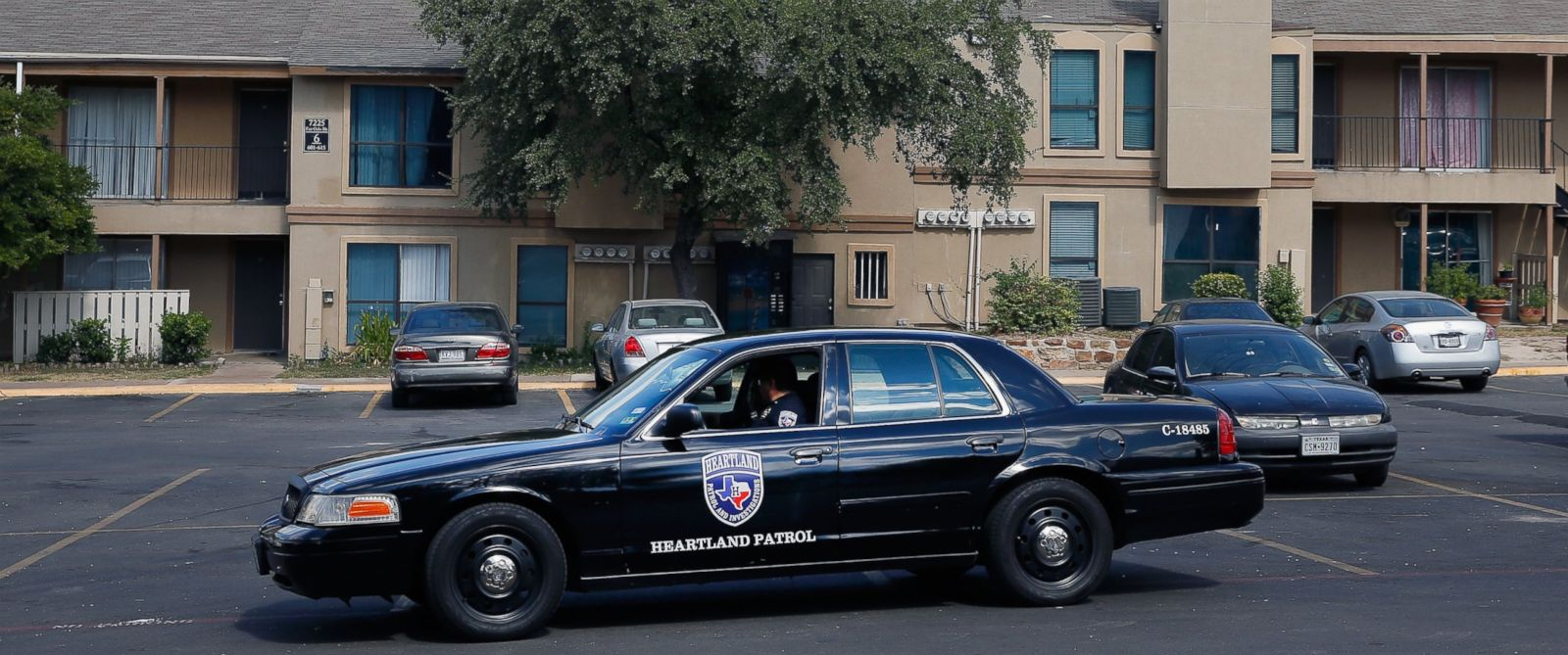 PHOTO: A private security guard patrols The Ivy Apartments where the confirmed Ebola virus patient was staying on Oct. 1, 2014 in Dallas.