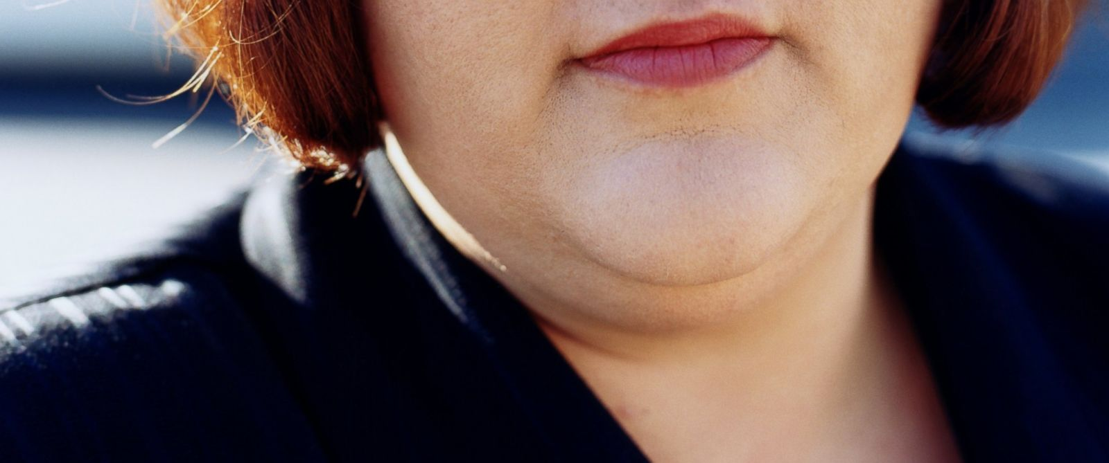 PHOTO: A woman with a double chin is seen in an undated stock photo.