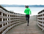 PHOTO: A woman runs on wooden dock.