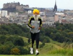 PHOTO: Fauja Singh poses for pictures after being the first person to officially enter for next years Edinburgh Marathon, Sept. 1, 2011 in Edinburgh, Scotland.