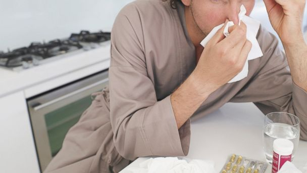 PHOTO: A stock image of a man with the flu.