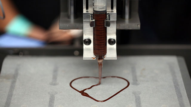 PHOTO: A 3-D printer creates a heart using chocolate during the 3-D Print show at the Business Design Center in London, Nov. 8, 2013.