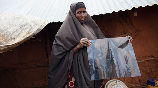 PHOTO: A refugee woman holds a x-ray diagnosing her with tuberculosis in the Ifo refugee camp which makes up part of the giant Dadaab refugee settlement on July 20, 2011 in Dadaab, Kenya.