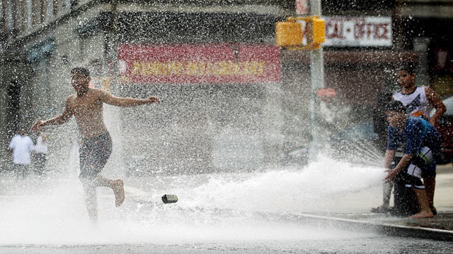 PHOTO: Children play in water sprayed from a fire hydrant on June 9, 2011 in the Bronx borough of New York City.