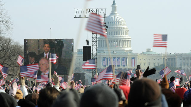 PHOTO: A large crowd cheers at the Washington Monument as Barack Obama prepares to take the oath of office during the Presidential inauguration in Washington on Jan. 20, 2009.