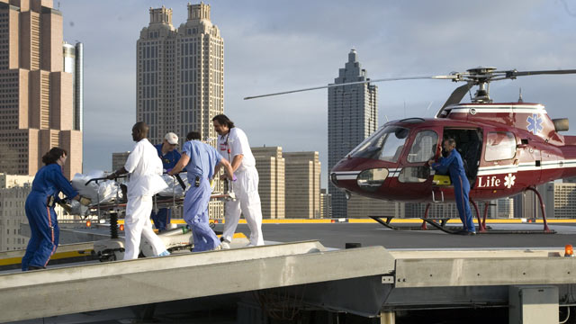 PHOTO: A man that was injured in a car accident arriving by helicopter and rushed to the trauma room for treatment, Grady memorial hospital on July 30, 2006 in Atlanta, Georgia.