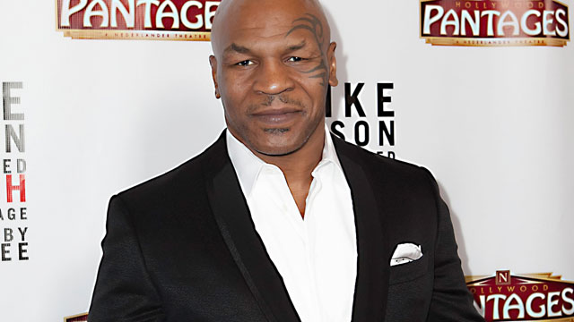 "PHOTO: Mike Tyson arrives to his show, ""Mike Tyson: Undisputed Truth"" at the Pantages Theatre on March 8, 2013 in Hollywood."