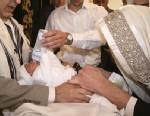 PHOTO: Mohel performing circumcision