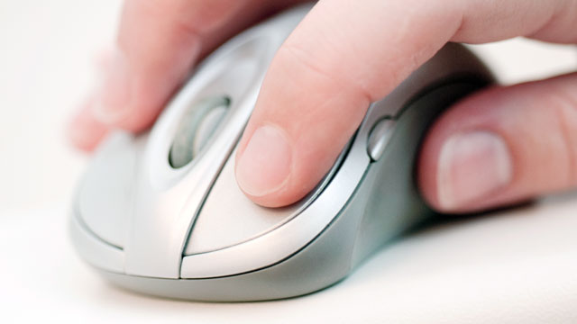 PHOTO: Computer mouse with hand.