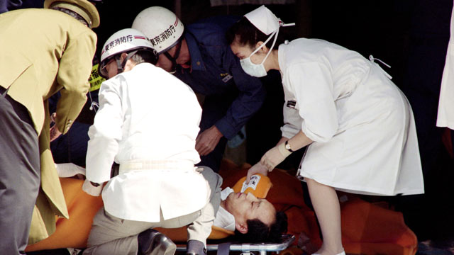 PHOTO: A commuter is treated by an emergency medical team at a make-shift shelter before being transported to hospital after being exposed to Sarin gas fumes in the Tokyo subway system during an Aum sect attack, March 20, 1995.