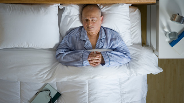 PHOTO: Senior man sleeping