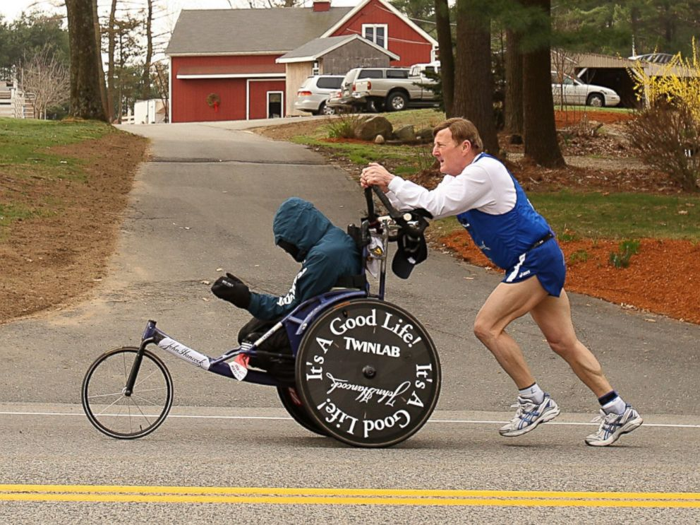 PHOTO: Dick Hoyt pushes Rick Hoyt as they compete in the 2008 Boston Marathon on April 21,2008 in Hopkinton, Massachusetts.