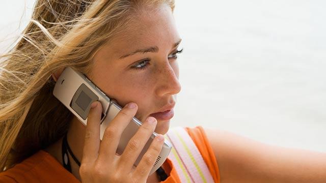 PHOTO: Teenage girl on cell phone