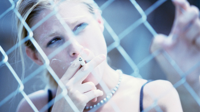 PHOTO: Teen girl smoking cigarette