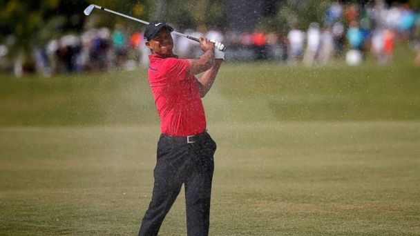 PHOTO: Tiger Woods plays a bunker shot on the fifth hole during the final round of the World Golf Championships-Cadillac Championship at Trump National Doral on March 9, 2014 in Doral, Florida.