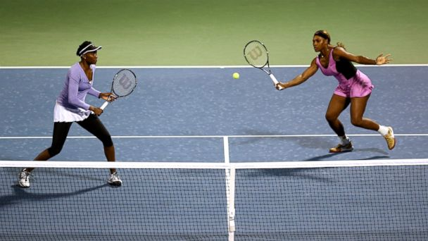 PHOTO: Venus Williams and Serena Williams of the USA in action during their doubles match against Ekaterina Makarova and Elena Vesnina of Russia at the Dubai Tennis Stadium on February 19, 2014 in Dubai, United Arab Emirates.