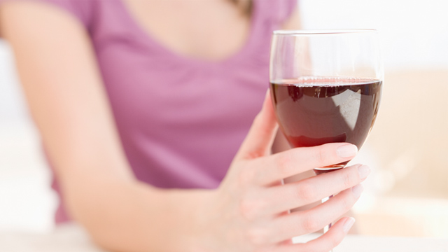 PHOTO: Woman holding glass of wine