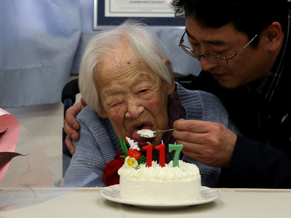 PHOTO: A nursing home employee helps Misao Okawa, who is recognised by Guinness World Records as the worlds oldest living person, eat her birthday cake on her 117th birthday celebration at Kurenai Nursing Home on March 5, 2015 in Osaka, Japan.