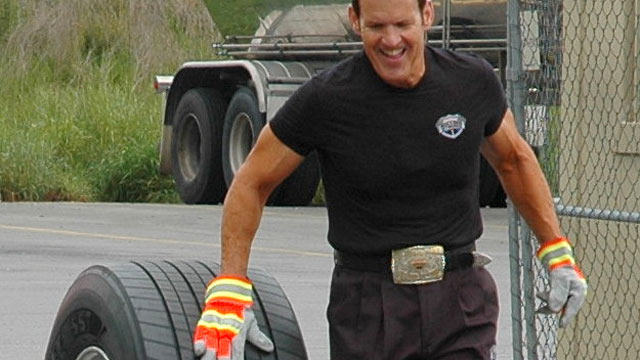 PHOTO: Bob Perry, Trucker Trainer and Rolling Strong Founder rolls a tire 63 miles in support of driver health and wellness.
